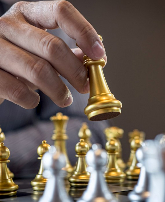 gold-and-silver-chess-with-player-intelligent-businessman-playing-chess-game-competition-to-planning_t20_Nx06Rl.jpg